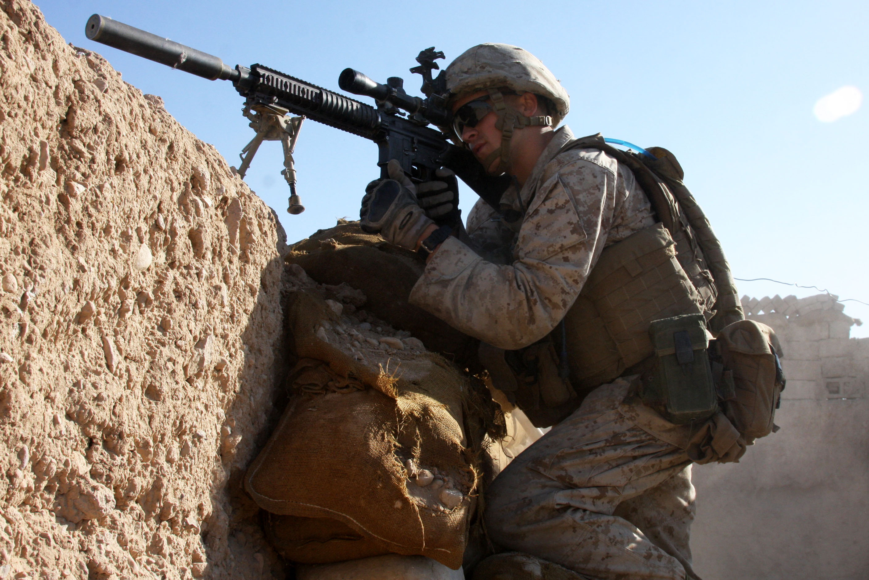 U.S. Marine Corps Lance Cpl. Steven J. Zandstra provides security at a checkpoint in Sangin, Helmand province, Afghanistan, on Nov. 1, 2010. Zandstra is assigned to Police Advisor Team 1, 3rd Battalion, 5th Marine Regiment, Regimental Combat Team 2, whose mission is to conduct counterinsurgency operations in partnership with the International Security Assistance Force. DoD photo by Lance Cpl. Jorge A. Ortiz, U.S. Marine Corps. (Released)